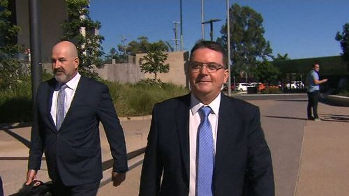 Logan Mayor Luke Smith (right) has vowed to fight corruption and perjury charges. (9NEWS)
