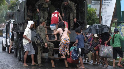 More than 200,000 people have been evacuated from coastal villages in the Philippines