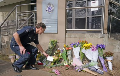 Victoria Police Deputy Commissioner Shane Patton lays a tribute at Boroondara Police near the Chandler Highway in the suburb of Kew in Melbourne, Thursday, April 23, 2020. Four police officers have died in a horror crash involving a truck on Melbourne's Eastern Freeway. (AAP Image/Scott Barbour) NO ARCHIVING
