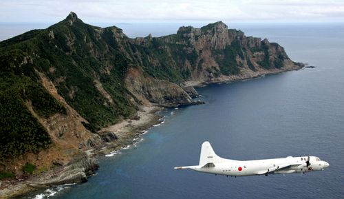 This file photo shows a Japanese surveillance plane flying over the Senkaku Islands.