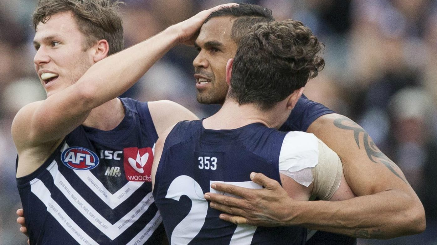 Shane Yarran of the Fremantle Dockers celebrates