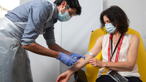 In this undated photo issued by the University of Oxford, a volunteer is administered the coronavirus vaccine developed by AstraZeneca and Oxford University, in Oxford, England. (University of Oxford/John Cairns via AP