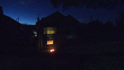 The Chan home overnight. A candlelight tribute to their family member Andrew burned bright as he was put to death in Indonesia in the early hours of the morning. (9NEWS)