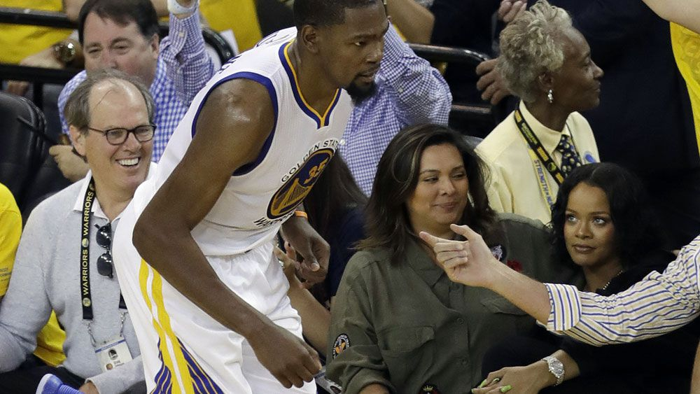 Golden State Warriors star Kevin Durant and Rihanna (right) didn't miss one another during game one of the NBA Finals. (AAP)