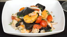 Sydney Seafood School's black stracci pasta with mussels, cuttlefish and prawns
