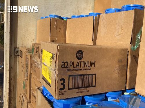 More than 4000 tins of formula were found in the search.