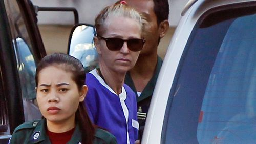 Tammy Davis-Charles gets off from a van at an appeals court in Phnom Penh, Cambodia. (AP)