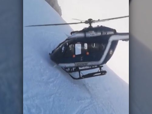 The pilot places the nose of the chopper into the side of the mountain with the blades rotating just millimetres from the snow as the dramatic rescue is performed.