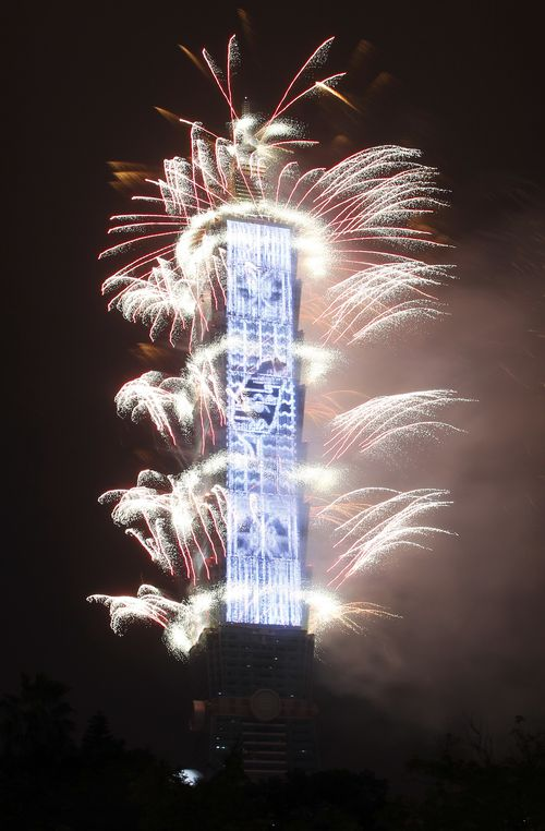 Fireworks explode from the Taipei 101 building during the New Year's celebrations in Taipei, Taiwan. (AAP)