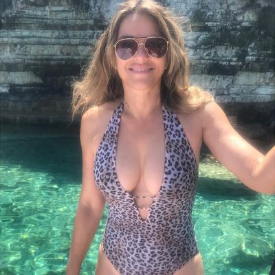 Liz Hurley shows off her latest swimwear design