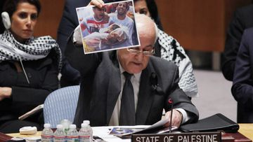 Palestine envoy to the United Nations Riyad Mansour showed photos of children killed in the latest Gaza violence as he pleaded for UN intervention. (Getty)