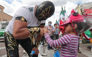 Pictures of the week: Mexican wrestlers hand out facemasks, Brisbane welcomes the AFL grand final, Trump and Biden visit Kenosha, protests rage across the US