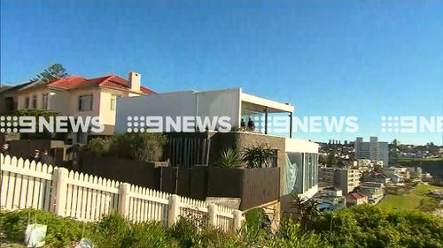 AFP, NSW Police and the Joint Organised Crime Group swoop on John Ibrahim's Dover Heights home.