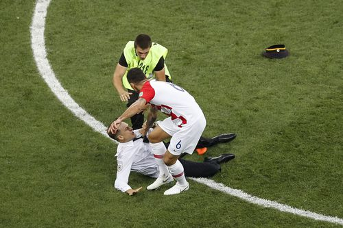 One of the protesters was stopped by Croatian defender Dejan Lovren. Picture: AAP
