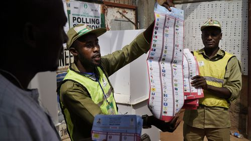 Explosions and delays as Nigeria's presidential election finally get underway