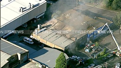 The factory is believed to contain a panel beating shop. (9NEWS)