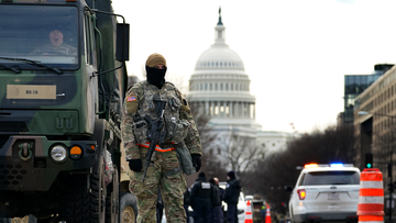 A National Guard stands at a road block outside the Capitol as security is ramped ahead of President-elect Joe Biden's inauguration ceremony Monday, Jan. 18, 2021, in Washington. (AP Photo/Matt Slocum)