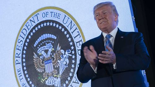 Donald Trump did not notice the presidential seal was mocking him.