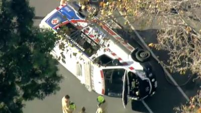Paramedics in hospital after ambulance rolls