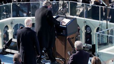 The podium is cleaned prior to President Joe Biden giving his inaugural address during the 59th Presidential Inauguration on January 20, 2021 in Washington, DC. During today's inauguration ceremony Joe Biden becomes the 46th president of the United States.