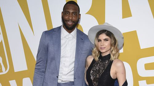 Rasual Butler and his wife Leah LaBelle in 2017. (AAP)