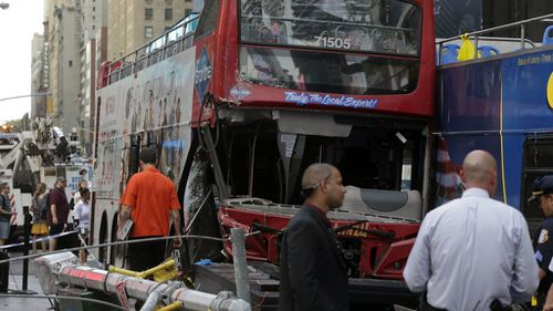 Two double-decker buses have collided in Times Square, New York. (AAP)