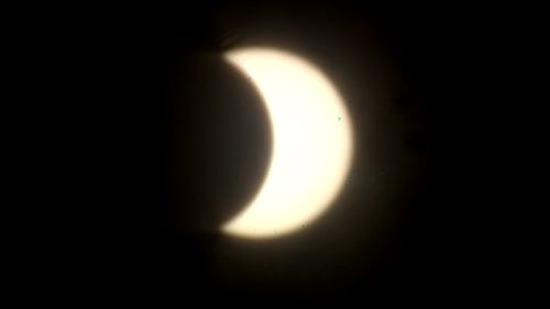 Otherworldly partial eclipse dominates Darwin skies