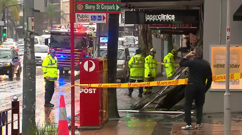 In Neutral Bay, the downpour was so heavy, a shop awning collapsed onto the footpath.