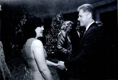 Monica Lewinsky meeting President Bill Clinton at a White House function.