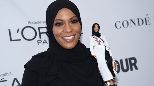 Ibtihaj Muhammad holds a Barbie doll in her likeness at the 2017 Glamour Women of the Year Awards in New York (Image: AP)