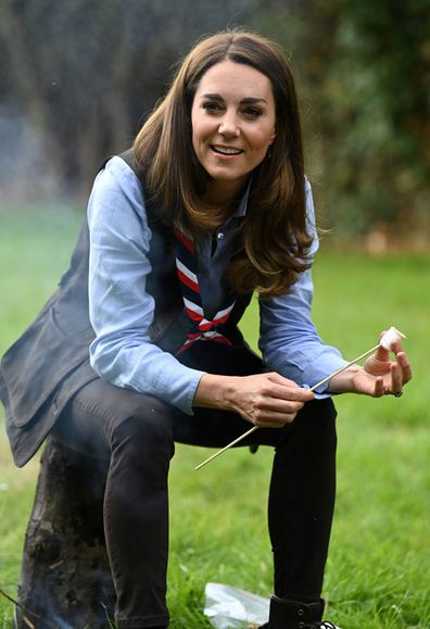 Duchess of Cambridge toasts marshmallows during her visit to a Scout Group in Northolt, northwest London where she joined Cub and Beaver Scouts in outdoor activities on September 29, 2020 in London, England