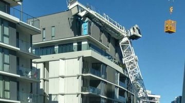 Residents still suffering months after crane toppled into building