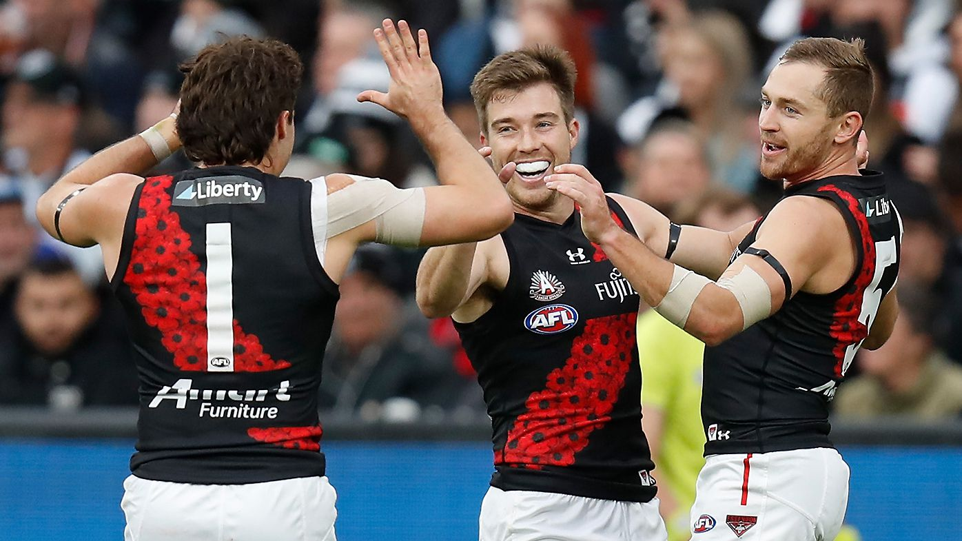 Andrew McGrath, Zach Merrett and Devon Smith