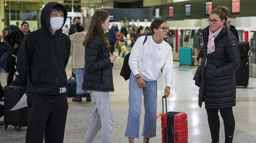 Passengers check-in at the Qantas departures terminal at Tullamarine Airport on July 07, 2020 in Melbourne ahead of the midnight border closure