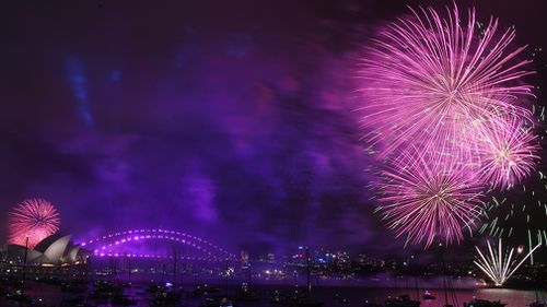 Fireworks explode over Sydney Harbour during New Year's Eve celebrations in Sydney. (AAP)