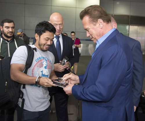 Arnie was mobbed by fans after touching down in Melbourne. (AAP)