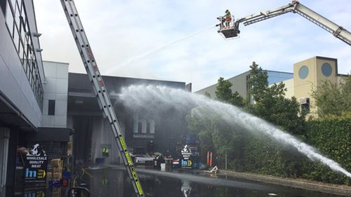 The fire is believed to have started in an air conditioning unit. (9NEWS)