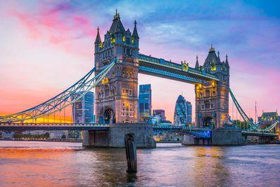 Pretty pink hues light up the sky at dusk at London Bridge. iStock