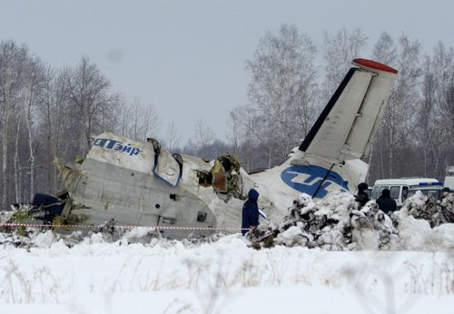 Russian Emergency ministry rescue workers search the site of the ATR-72 plane crash outside Tyumen, a major regional center in Siberia, Russia, Monday, April 2, 2012. A passenger plane crashed in Siberia shortly after take-off on Monday morning, killing 31 of the 43 people aboard, Russian emergency officials said, with 12 survivors were hospitalized in serious condition. The ATR-72, a French-Italian-made twin-engine turboprop, operated by UTair was flying from Tyumen to the oil town of Surgut with 39 passengers and four crew. (AP Photo/Marat Gubaydullin)