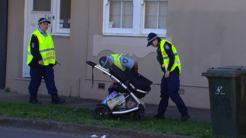 Police inspect the pram in Five Dock, Sydney.