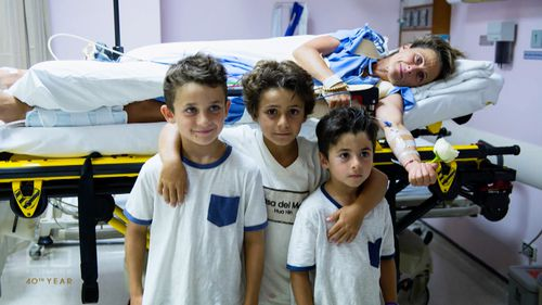 Sam in hospital with her three boys.