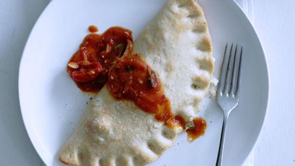 Three-cheese calzone with tomato-chilli sugo
