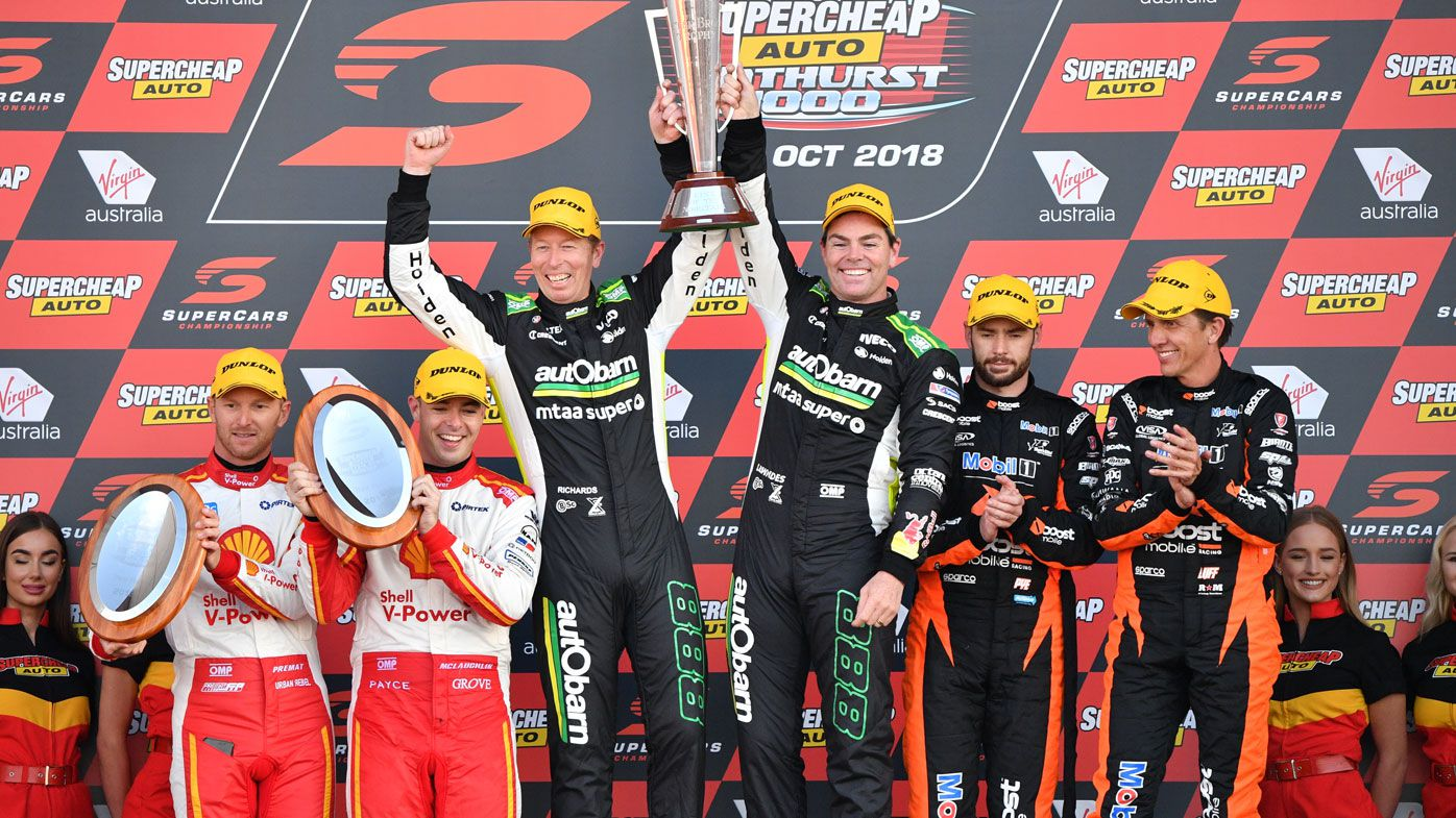 Craig Lowndes (right) and Steven Richards of Autobarn Lowndes Racing celebrate winning the Bathurst 1000 V8 Super Cars Championship in 2018