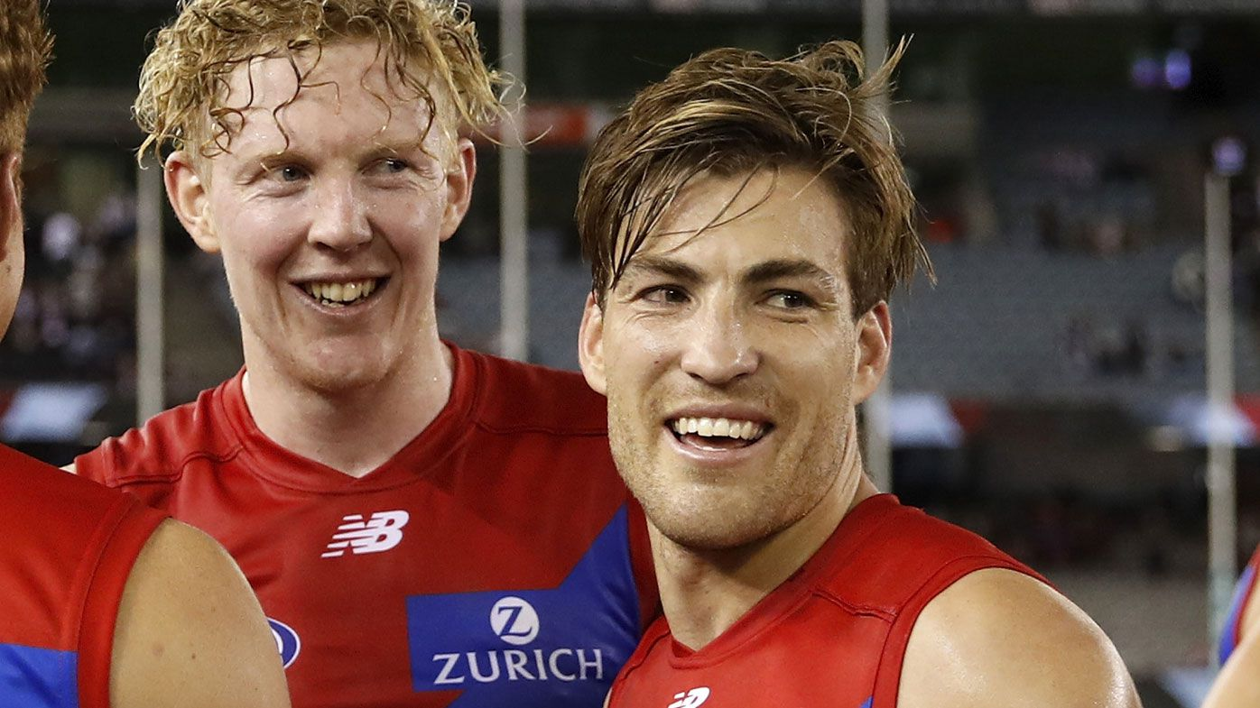 Oskar Baker of the Demons, Clayton Oliver of the Demons and Jack Viney of the Demons celebrate a win during the 2021 AFL Round 02 match between the St Kilda Saints and the Melbourne Demons at Marvel Stadium on March 27, 2021 in Melbourne, Australia. (Photo by Dylan Burns/AFL Photos via Getty Images)