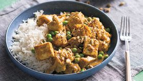 Indian curry with paneer, cauliflower and peas