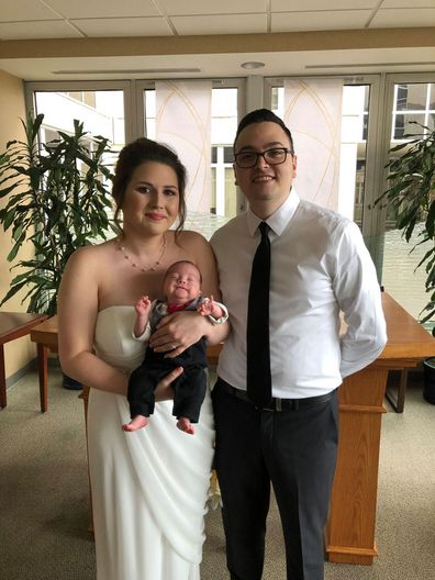 Bride carries premature baby down aisle at wedding