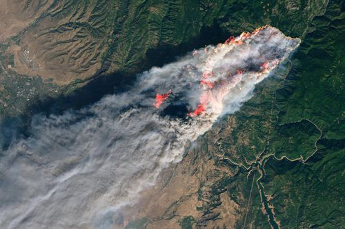 An enhanced satellite image provided by NASA's Earth Observatory showing the Paradise wildfire.