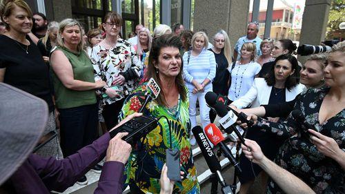 Julie Davis speaks to reporters outside court.