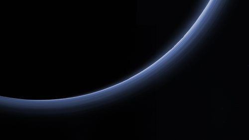 Scientists believe the blue glow is a photochemical smog.  (NASA/Johns Hopkins University Applied Physics Laboratory/Southwest Research Institute)