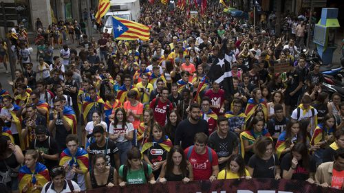 An evening march to mark the anniversary of a referendum that was part of a thwarted bid for independence last year in Barcelona, drew an estimated 180,000 people.